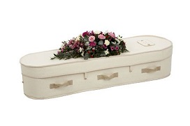 woollen casket with fabric handles and flowers on top